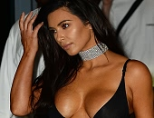 Kim Kardashian leaving her hotel in Miami Beach showing cleavage in see through dress
