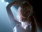 Kim Basinger stripping out of her slightly see through lingerie