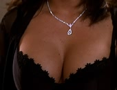 Tiffani-Amber Thiessen boobs popping out of sexy lingerie