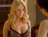 Alice Eve strips to her underwear and shows huge cleavage in her bra