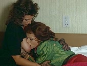 Isabelle Huppert laying with her head on a woman tits and then kisses them