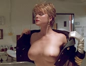 Erika Eleniak shows buns in a thong & bare boobs when she jumps out of a cake