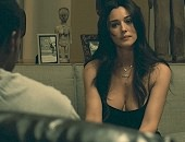 Monica Bellucci showing her cleavage in a sexy black dress