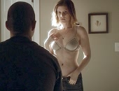 Kate Mara stripping down to her bra in the movie Man Down