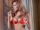 Raquel Welch strips to her sexy red lingerie shows cleavage