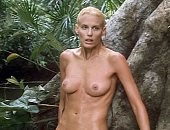 Daryl Hannah laying flly naked against a tree in the forest