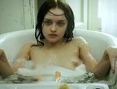 Quick look at Olivia Cooke's boobs as she sits up in the tub
