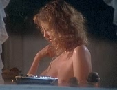 Susan Sarandon washes her boobs in front of the kitchen sink
