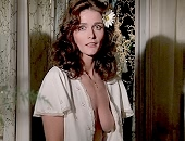 Margot Kidder stands around in an open blouse shows tits in mirror
