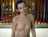 Emily Browning naked in the tub showing her tits as she stands up