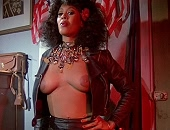 Marilyn Joi opening up her leather jacket to expose her breasts