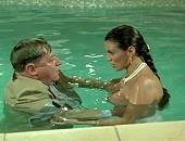 Serena Grandi cleavage in a white dress & nice big tits in the pool