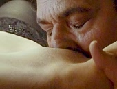 Flora Martinez naked in black stockings gets her pussy eaten