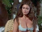 Cynthia Myers showing huge cleavage in a bikini top