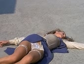 Ursula Andress upskirt exposes panty and stockings