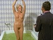 Ursula Andress splashing around fully naked in a huge bath