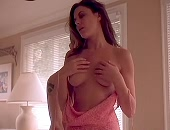 Kari Wuhrer shows her tits & ass as she undresses and has sex