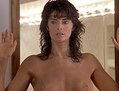 Joan Severance shows her tanned boobs as she drops her towel