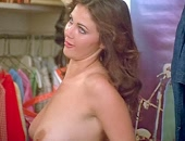 Lynda Carter shows her boobs when she changes her shirt