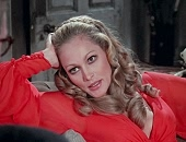 Ursula Andress shows cleavage in a red dress & naked in bed