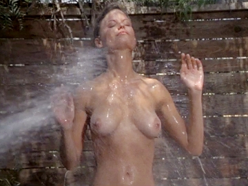 kay lenz showing her nice tits as a guy sprays her with a hose
